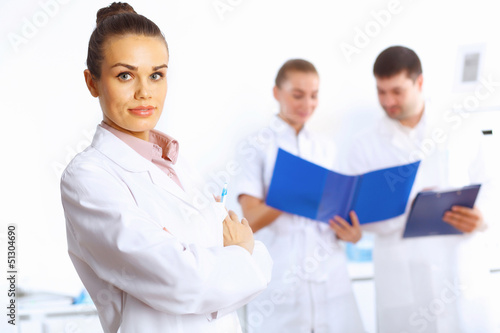 Young female doctor in white uniform