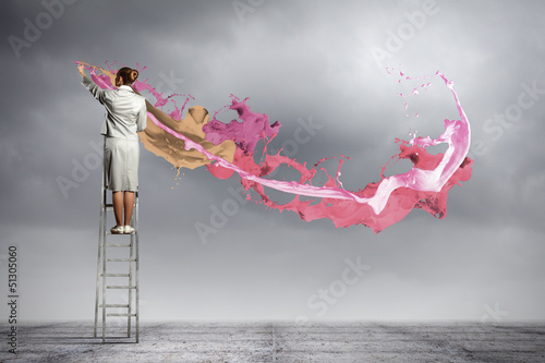 Young woman drawing splashes