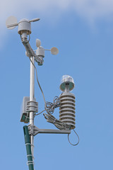 Weather station with a blue sky and clouds
