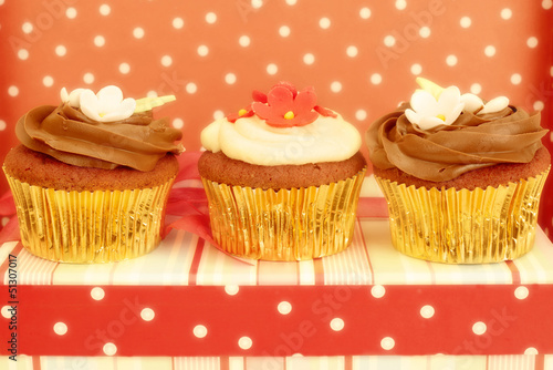 Cupcakes decorated in chic polka dots background