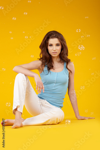 woman smiling isolated on yellow background