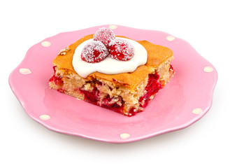 cranberries dessert with cream cheese topping on pink plate