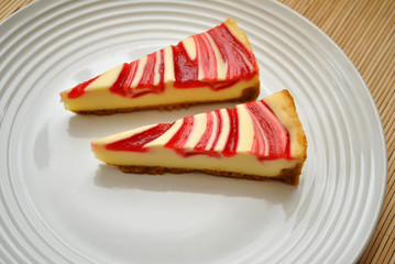 Two Slices of Strawberry Swirl Cheese Cake