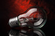 Light bulb on black and red background