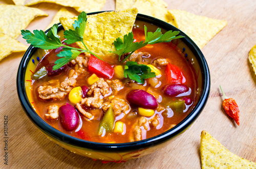 Mexican soup with tacos