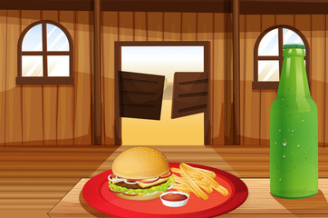 A burger and fries in a red plate and a bottle of soda