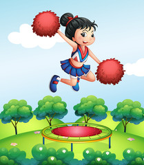 A cheerleader above a trampoline