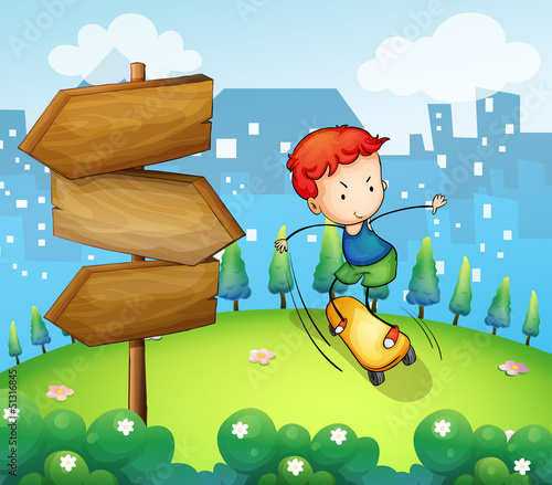 A boy playing skateboard beside the wooden arrows