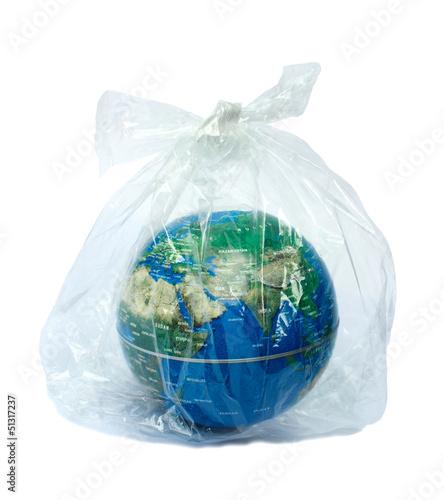Leinwanddruck Bild The earth in plastic bag