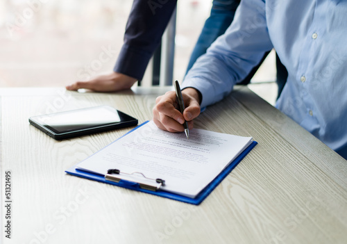 Business man  writing on paper