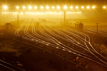 Freight train field under the curtain of night,