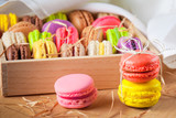 traditional french colorful macarons in a rows in a box poster