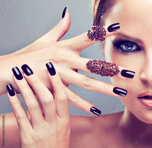 Blonde model  with burgundy manicure