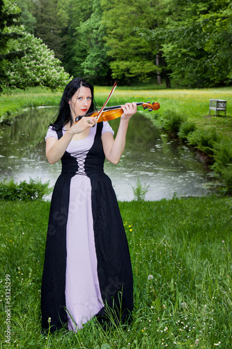 Woman playing violin in the park