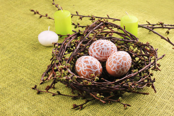 Easter composition with eggs and candles