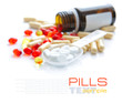 Leinwanddruck Bild - Pills are in a spoon on a background the color capsules