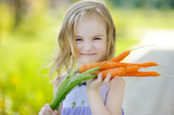 Adorable little girl with carrots