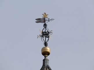 A Vintage Metal Rooftop Weather Wind Vane.