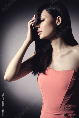 beautiful brunette woman with elegant hairstyle wearing nice cor