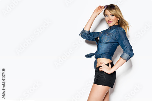 sexy woman wearing jeans shirt and shorts