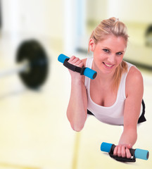 Young pretty woman holding weights and doing body training