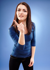 Young woman scolding and pointing finger