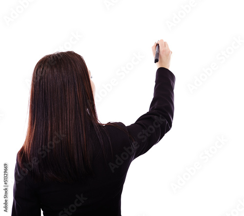 Businesswoman writing on invisible object
