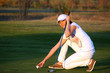 girl golf player preparing for shot