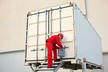 technician with tool case opening movable workshop in container