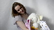 young pregnant woman is looking for a new baby stuff