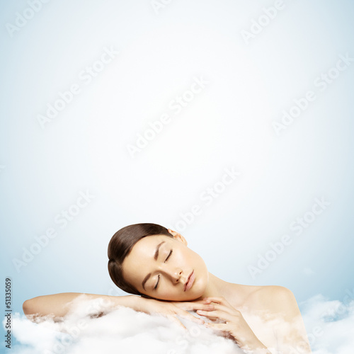 pretty young girl sleeping on a cloud