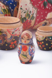 wooden babushka figures on white