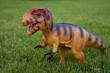 dinosaur toy on grass