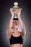 Young Woman Lifting Trophy