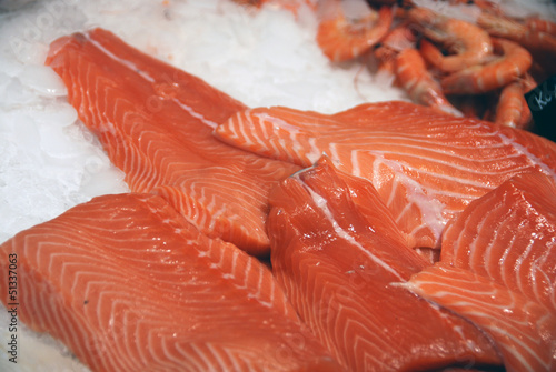 Salmon fillets on ice at fishmonger