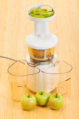 slow juicer making apple juice
