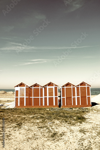 old wooden cabins on the beach