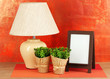 Brown photo frame and lamp