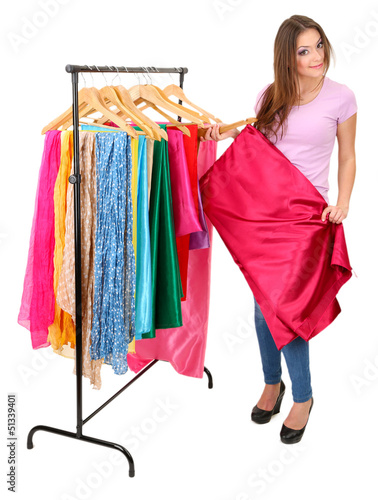 Young girl chooses fabric for future dress isolated on white