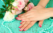 Closeup of hands of young woman with elegance manicure,