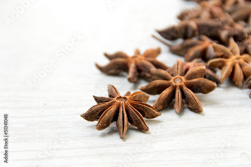 Anise spice over a white wooden background.