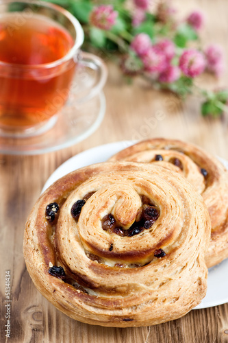 Puff buns with raisin and cup of tea