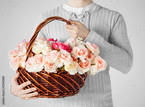 man holding basket full of flowers