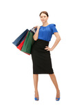 businesswoman with shopping bags on high heels