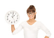 businesswoman with wall clock