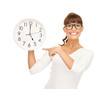 businesswoman pointing her finger at wall clock