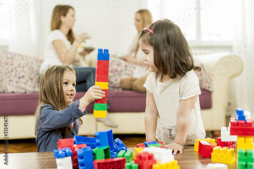 Little girls playing in the room