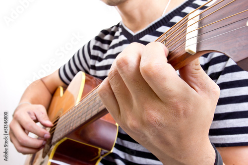 Guiter player picking music in studio