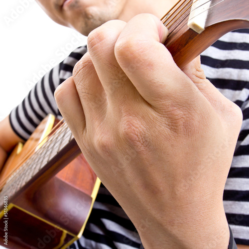 Guiter player picking music in studio