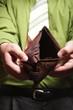 Empty wallet in male hands - poor economy